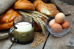Bread, milk and eggs Stock Images