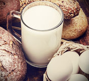 Bread, milk, flour and eggs Royalty Free Stock Image