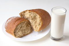 Bread and milk. Fresh bread with glass of milk Royalty Free Stock Photos
