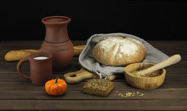 Bread with milk. Fresh bread with milk and pumpkin stock photos