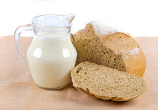 Bread and milk in pitcher Stock Photos