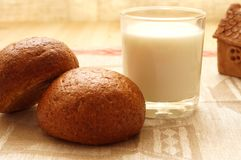 Bread and milk. On the table. Ceramic products in the background Stock Photography