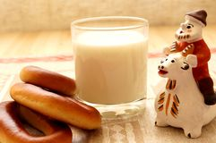 Bread and milk. On the table. Near clay toys Stock Images