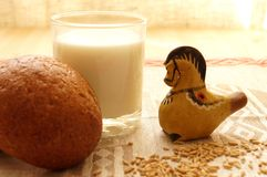 Bread and milk. On the table. Near folk clay toy Royalty Free Stock Photos