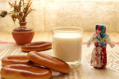 Bread and milk. On the table. Near folk doll Royalty Free Stock Images