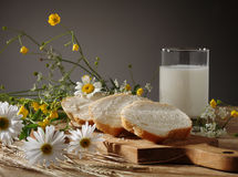 Bread, milk and wild flowers Royalty Free Stock Images