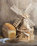 Bread and mill on sacking background Stock Image