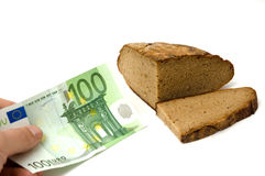 Bread and money Royalty Free Stock Photography