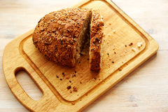 Bread. Morning bread lay on a chopping board Stock Images