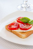 Bread with mozzarella tomatoes and basil Royalty Free Stock Photography