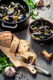 Bread and mussels  with garlic and parsley Royalty Free Stock Photography