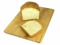 Bread n Bread Board. OLYMPUS DIGITAL CAMERA Half a loaf of bread and slice on bread board isolated over white royalty free stock photos