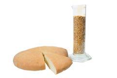 Bread near beaker Royalty Free Stock Image