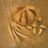 Bread, nuts and wheat in the matting Royalty Free Stock Image