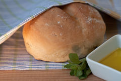Bread and Oil. Fresh white bread with olive oil Stock Photo