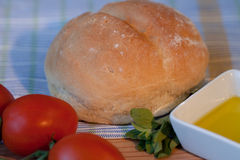 Bread and Oil. Fresh white bread with olive oil and tomatos Royalty Free Stock Photo