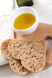 Bread and oil Stock Images