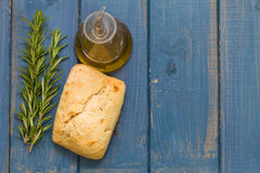 Bread and oil on blue Royalty Free Stock Image