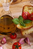 Bread, oil, garlic and tomatoes Royalty Free Stock Photos