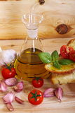 Bread, oil, garlic and tomatoes Royalty Free Stock Image