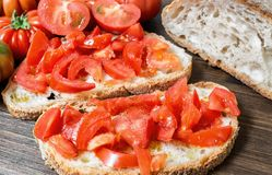 Bread oil, tomato, salt and pepper. Bread oil and tomato. Appetizing very fresh food typical of the Mediterranean diet, seasoned with the addition of salt and Stock Photography