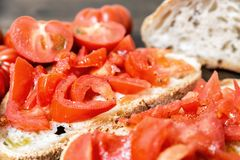 Bread oil, tomato, salt and pepper. Bread oil and tomato. Appetizing very fresh food typical of the Mediterranean diet, seasoned with the addition of salt and Stock Image