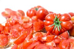 Bread oil, tomato, salt and pepper. Bread oil and tomato. Appetizing very fresh food typical of the Mediterranean diet, seasoned with the addition of salt and Royalty Free Stock Photos