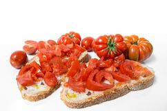 Bread oil, tomato, salt and pepper. Bread oil and tomato. Appetizing very fresh food typical of the Mediterranean diet, seasoned with the addition of salt and Royalty Free Stock Image