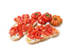 Bread oil, tomato, salt and pepper. Bread oil and tomato. Appetizing very fresh food typical of the Mediterranean diet, seasoned with the addition of salt and Royalty Free Stock Photography