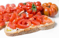 Bread oil, tomato, salt and pepper. Bread oil and tomato. Appetizing very fresh food typical of the Mediterranean diet, seasoned with the addition of salt and Stock Images
