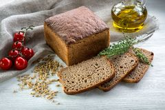 Bread with oil, tomatoes and seeds Royalty Free Stock Photo