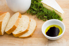 Bread, oil and vinegar, and brie cheese Stock Photo