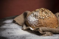 Bread  on the old board Royalty Free Stock Image