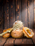 Bread on a old wooden boards Royalty Free Stock Photography