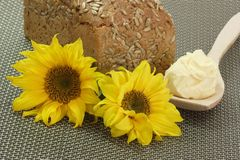 Bread with Oleo and Sunflowers Stock Photography