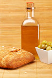 Bread, olive oil bottle and olives. Bread, olive oil bottle and some olives on wooden background. Shallow depth of field royalty free stock images