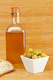 Bread, olive oil bottle and olives. Bread, olive oil bottle and some olives on wooden background. Shallow depth of field stock photo