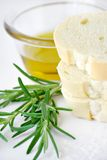 Bread olive oil and rosemary Royalty Free Stock Images