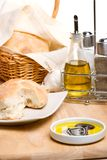 Bread, olive oil and spices. Extra virgin olive oil with balsamic vinegar and fresh Italian bread on wooden cut board Royalty Free Stock Image
