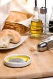 Bread, olive oil and spices Stock Images