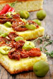 Bread with olive oil with sun-dried tomatoes. Royalty Free Stock Photography