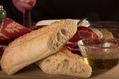 Bread and Olive Oil. With table setting on bamboo cutting board. Fall napkin in background royalty free stock photo