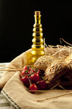 Bread, olive oil and tomato. Bread, olive oil and vegetables on the table Royalty Free Stock Photography
