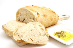 Bread with olive oil on white. Isolated photo of bread with olive oil on white Royalty Free Stock Photography