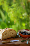 Bread and olives. Bread and olives, traditional ingredients of mediterranean cuisine Stock Images