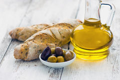 Bread with olives and olive oil Royalty Free Stock Images