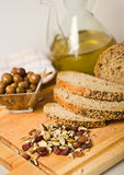 Bread, olives, seed and olive oil. Royalty Free Stock Photo