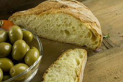 Bread, olives and tomatoes Stock Photos