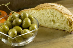 Bread, olives and tomatoes Stock Images