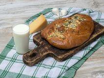 Bread with olives on a wooden table. Stock Image